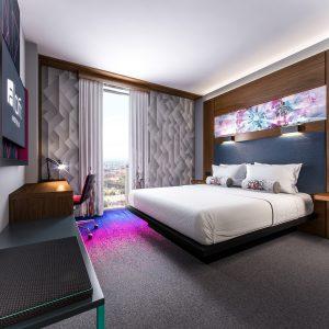 The comfortable bedroom at ALOFT Birmingham Eastside